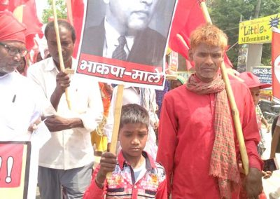 Holding Red Flag and Ambedkar's poster, firmly marching for the Rights.