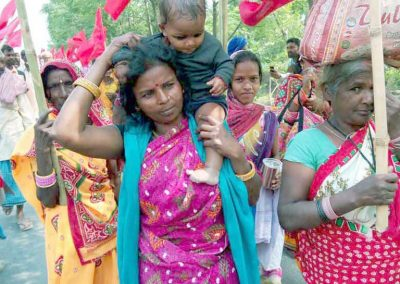 Woman with her infant taking part in the Padyatra along with her comrades